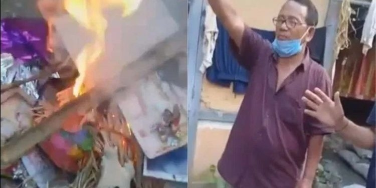 Pastor burns image of dei