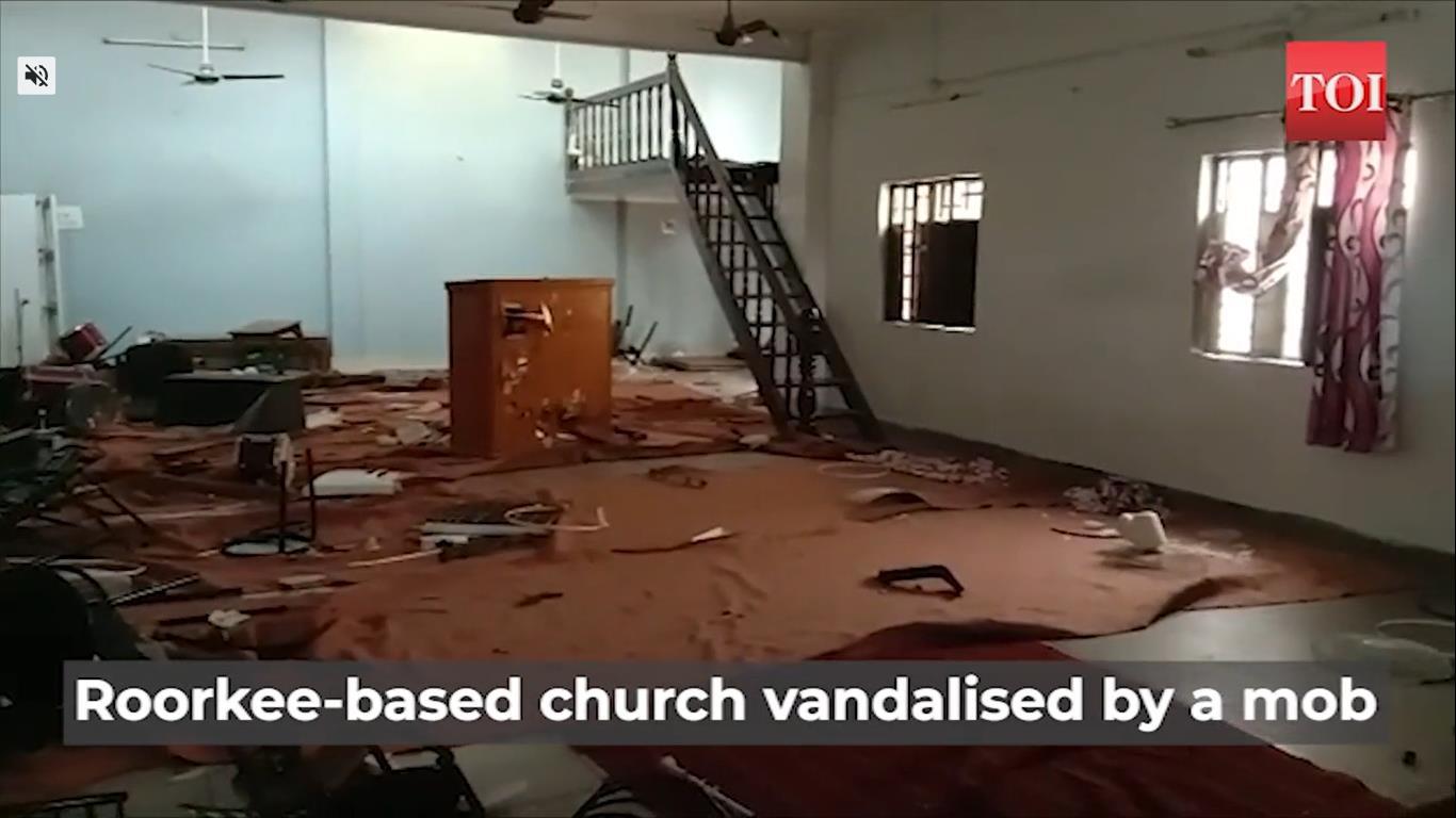 Angry mob vandalizes chur